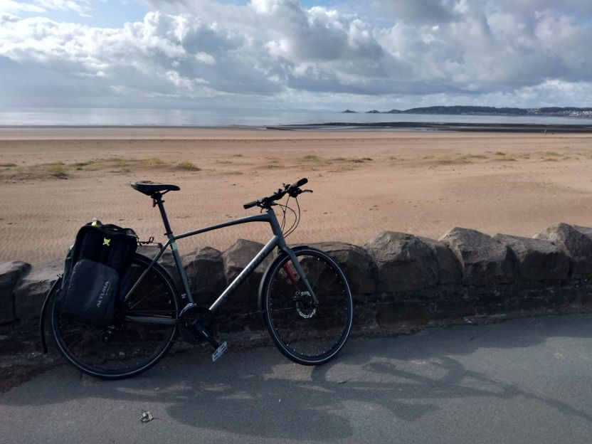 commuter bike on cycle path with scenic beach in the background