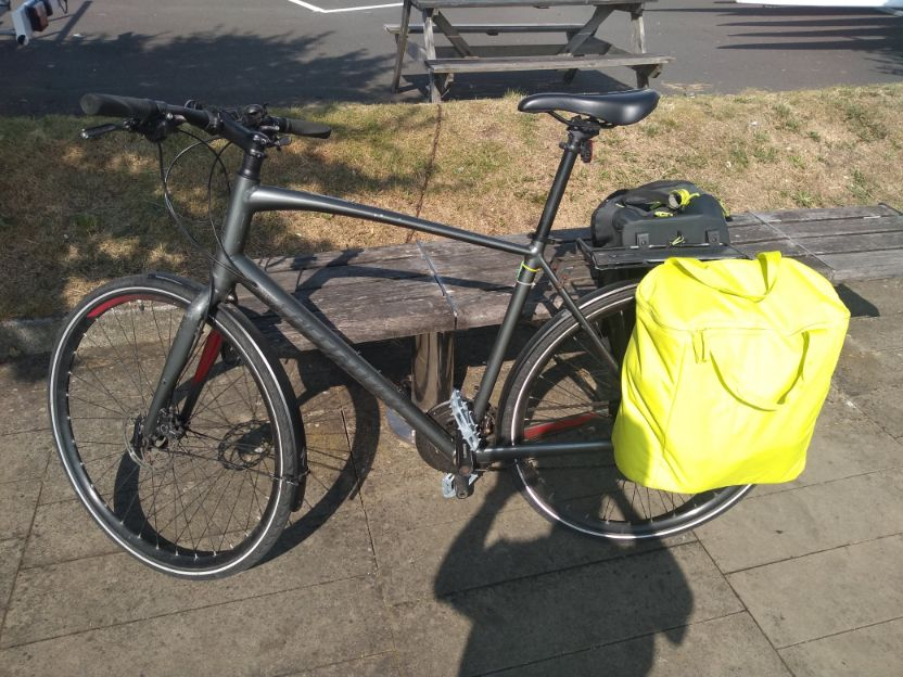 commuter bike with rear rack and panniers