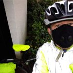 selfie of cyclist with helmet, reflective jacket and anti-pollution mask on