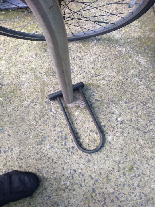 bike lock on stand left on floor