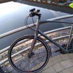 commuter bike leaning against handrails