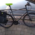 hybrid commuter bike next a body of water