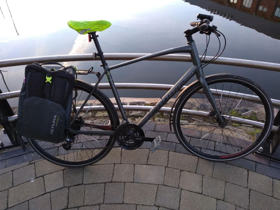hybrid commuter bike next a body of water