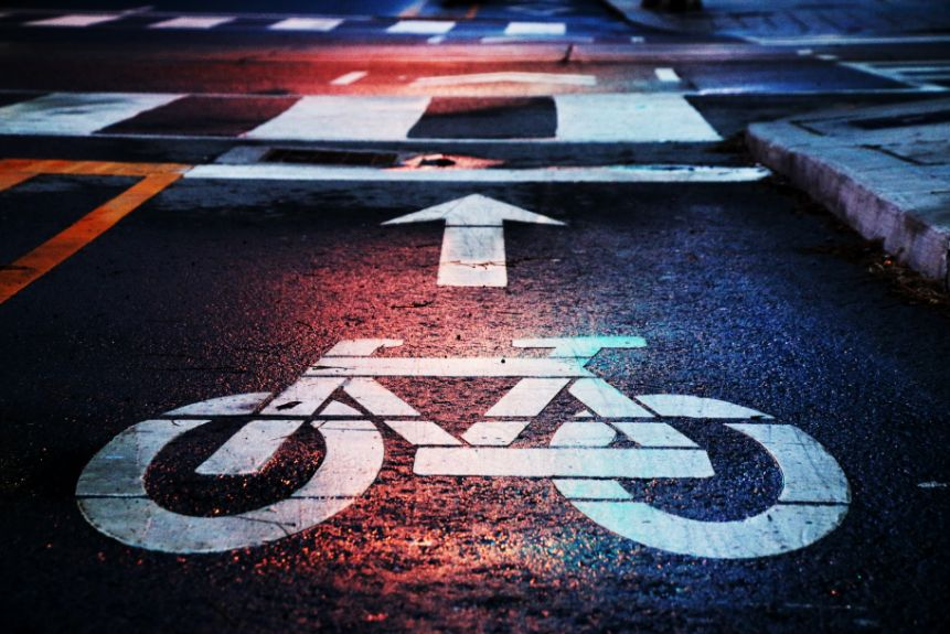 bicycle painted on road to indicate cycleway